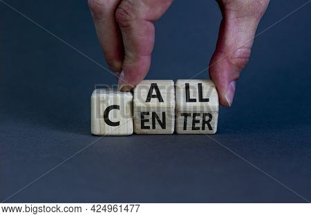 Call Center Symbol. Businessman Turns Wooden Cubes With Words 'call Center'. Beautiful Grey Backgrou
