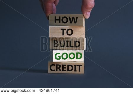 Build Good Credit Symbol. Wooden Blocks With Words 'how To Build Good Credit'. Businessman Hand. Bea