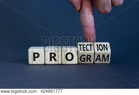 Protection Program Symbol. Businessman Turns Wooden Cubes And Changes The Word 'program' To 'protect