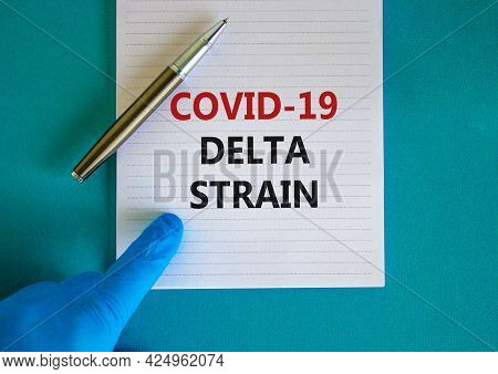 New Covid-19 Delta Variant Strain Symbol. Hand In Blue Glove With White Card. Concept Words 'covid-1