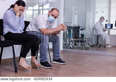 Young Woman With Protection Mask Receiving Devastating News From Doctor About Her Health, Starts Cry