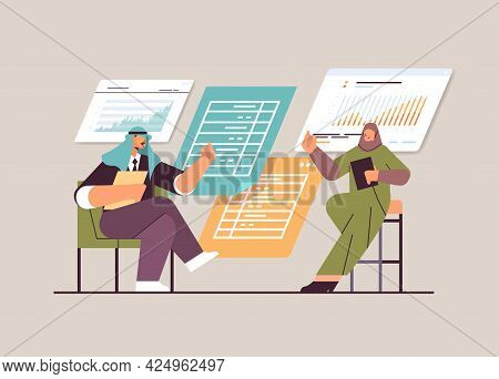 Arab Businesspeople Analyzing Financial Data On Charts And Graphs Planning Report Market Analysis Ac