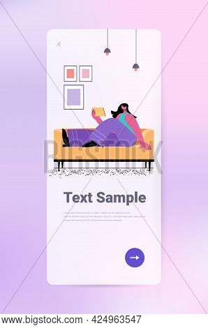 Woman On Sofa Using Tablet Pc Social Media Network Communication Concept Full Length