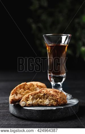 Tasty Cantucci And Glass Of Liqueur On Wooden Table. Traditional Italian Almond Biscuits