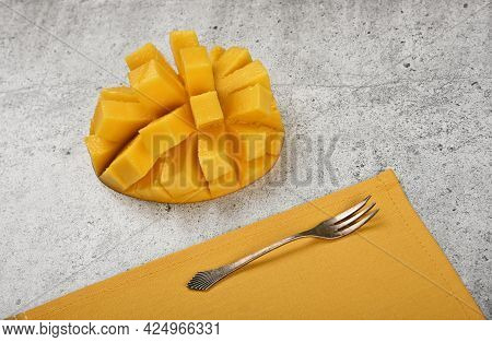 Close Up Serving Fresh Ripe Cut Mango Dessert On Gray Stone Table, Elevated Top View, Directly Above