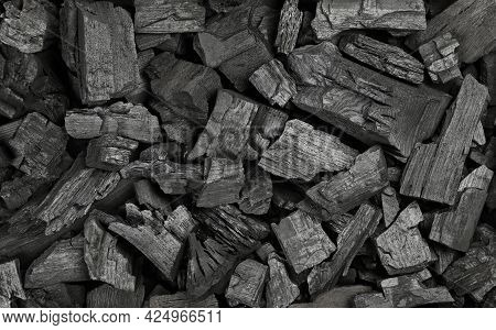 Close Up Background Texture Of Many Black Lump Charcoal Pieces Ready For Barbecue Grill, Elevated To
