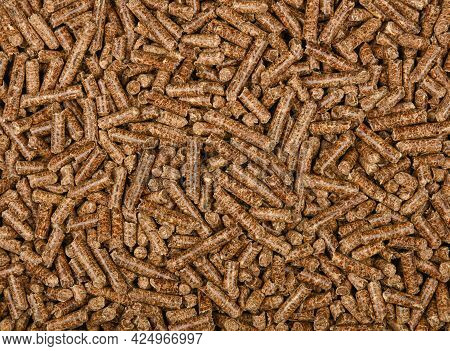Close Up Background Pattern Of Hardwood Pellets For Food Smoking And Cooking, Elevated Top View, Dir