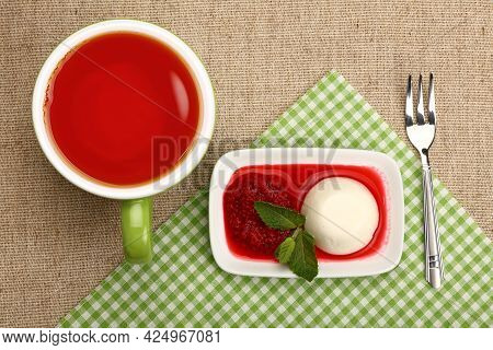 Close Up Serving Panna Cotta Traditional Italian Dessert With Raspberry Jam And Cup Of Red Black Tea