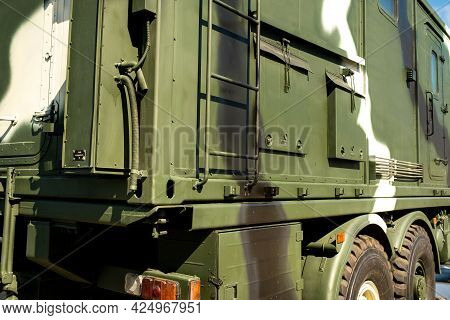 A Close-up Of The Body Of A Military Car On The Side Is Green. Military Concept