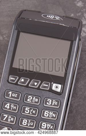 Payment Terminal, Credit Card Reader Using For Cashless Paying. Finance And Banking Concept