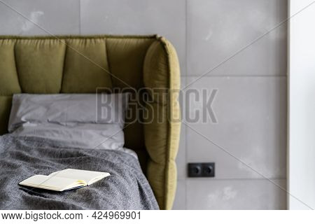 Cropped Shot Of Minimalistic Modern Bedroom Interior With Comfy Soft Bed Decorated With Gray Bedding