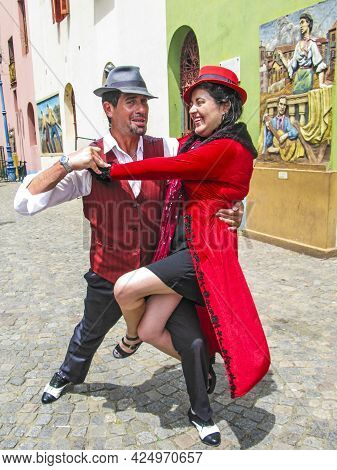 Buenos Aires, Argentina - January 26, 2015: Tango Dancer Pose For Tourists In Caminito Street, Bueno