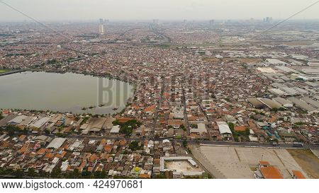 Aerial Cityscape City Surabaya With Skyscrapers, Buildings And Houses. Urban Environment In Asia Cit