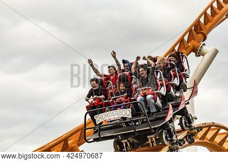 Coney Island, Usa - October 25, 2015: People Enjoy Riding The Roller Coaster At Coney Island, The Am