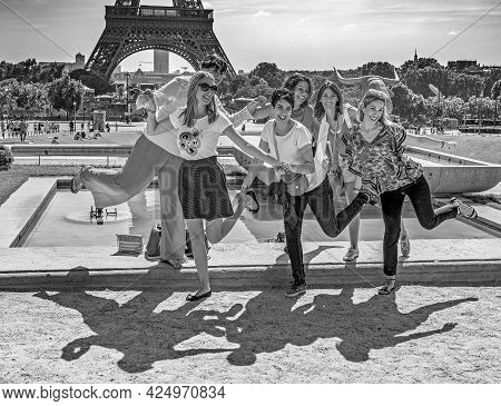 Paris, France - June 13, 2015:  Tourists Pose In Front Of Eiffel Tower In Paris, France. The Eiffel