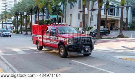 Miami Beach, Florida Usa - April 15, 2021: Red Ford Fire Rescue Truck In Miami Beach Corner View.