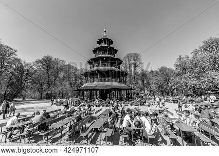 Munich, Germany - April 20, 2015: People Enjoy The  Biergarten Near Chinese Tower In English Garden