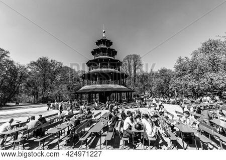 Munich, Germany - Apr 20, 2015: People Enjoy The  Biergarten Near Chinese Tower In English Garden In