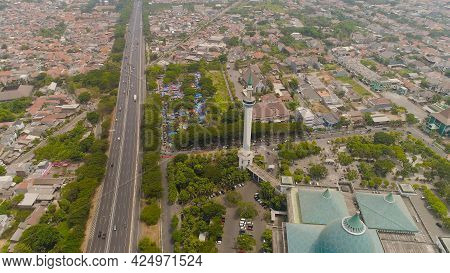 Aerial View Cityscape City Surabaya With Mosque Al Akbar, Highway, Buildings And Houses. Mosque In I
