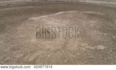 Mud Volcano With Bursting Bubble Bledug Kuwu. Aerial View Volcanic Plateau With Geothermal Activity