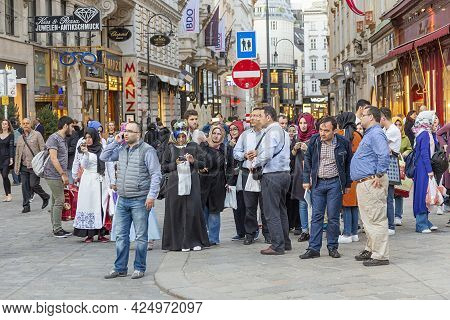 Vienna, Austria - April 25, 2015:  Foreign Tourists From European And Arabic Countries Visit Vienna