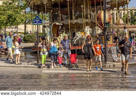 Paris, France - June 13, 2015:  People Visit The Landmarks Of Paris And Wait For Green Light To Cros