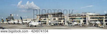 Frankfurt, Germany - July 6, 2015: Terminal 1 With Passengers Airplane Decking In Frankfurt, Germany