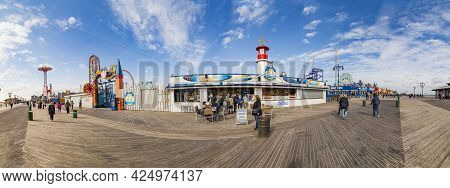 Coney Island, Usa - October 25, 2015: People Visit Famous Old Promenade At Coney Island, The Amuseme