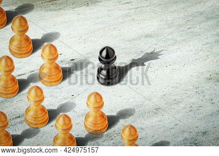 Black Pawn With The Shadow Of The Queen, In Front Of The White Pawns. Leadership Concept. Strength A