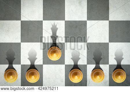 Pawn With The Shadow Of The Queen, In Front Of The Pawns. Top View. Leadership Concept. Strength And
