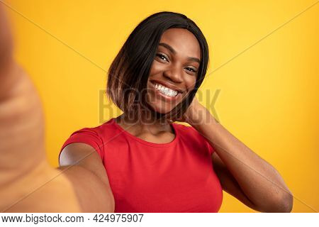 Toothy African American Woman Making Selfie Posing Over Yellow Background