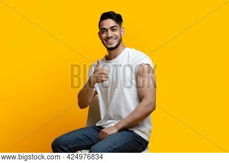 Happy Arab Man Showing Arm With Band On And Thumb Up