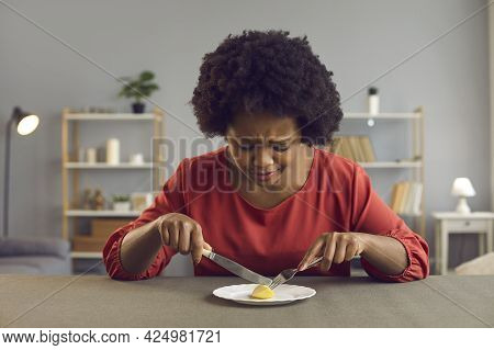 Sad Young Woman Whos Sticking To Strict Diet Eating One Piece Of Apple For Lunch