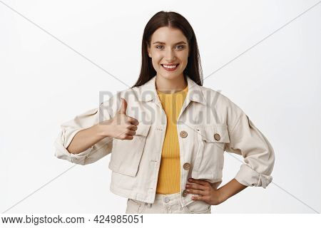 Portrait Of Confident Girl Show Thumb Up And Nod In Approval, Say Yes, Praise And Agree, Recommend E