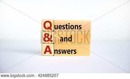 Q And A, Questions And Answers Symbol. Concept Words 'q And A Questions And Answers' On Wooden Block