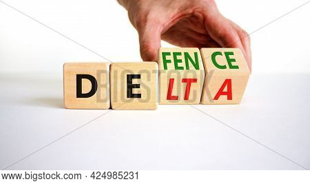 Covid-19 Delta Variant Strain Defence Symbol. Doctor Turns The Wooden Cube And Changes The Word Delt