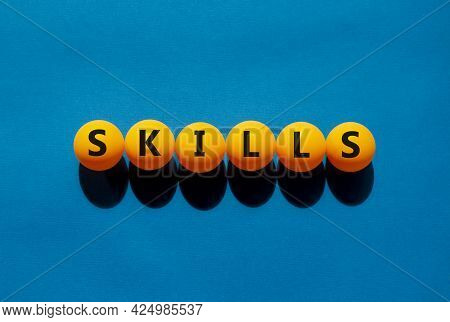 Skills And Business Symbol. The Concept Word 'skills' On Orange Table Tennis Balls On A Beautiful Bl