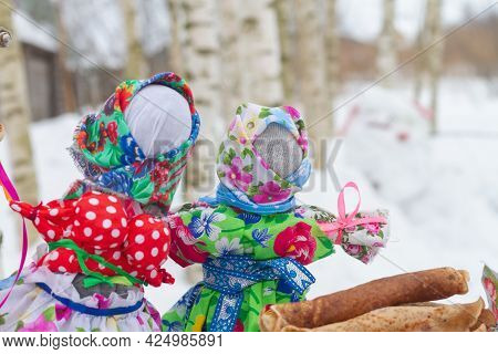 Two Rag Dolls In Traditional Russian Clothes For The Maslenitsa Holiday.