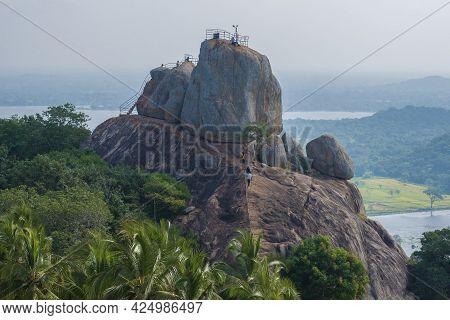 Mihintale, Sri Lanka - February 05, 2020: View Of The Invitation Rock (aradhana Gala) On A Foggy Mor