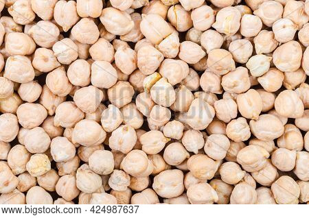 Close Up The Uncooked Chickpeas On Chickpeas Background.