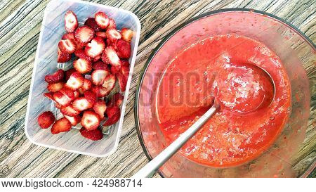 Strawberry Puree And Berries Are Placed In Food Containers. Glass Bowl With Fruit And Berry Puree In