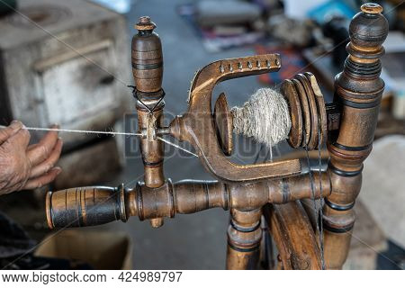 Thread In The Old Spinning Wheel Wool Hand