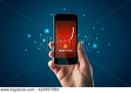 Meme Stock Investment Warning Concept With Smart Phone. Soaring Graph Of Stock Or Cryptocurrency And