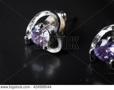Close Up Shoot Of Silver Earring With Faceted Amethyst Gem