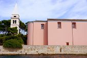 The church and the campanille of Veli Losinj in Croatia poster