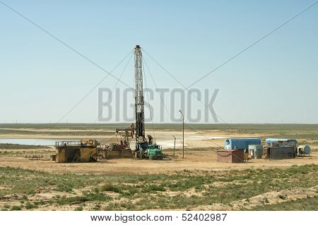 Drilling Rig In The Desert.