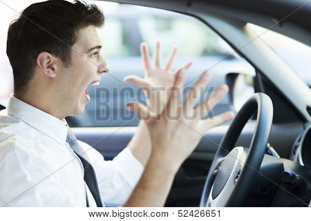 Frustrated man driving car