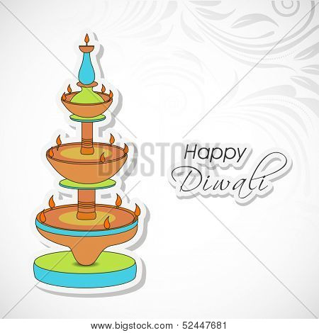 Indian festival of lights, Shubh Dipawali (Happy Dipawali) greeting card with colorful traditional oil lit lamps on floral decorated grey background.
