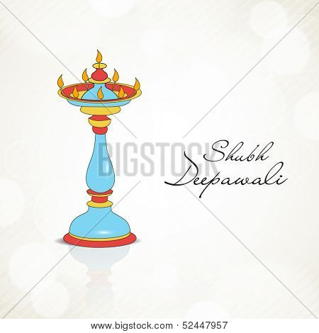 Indian festival of lights, Shubh Dipawali (Happy Dipawali) greeting card with colorful traditional oil lit lamps on shiny background.