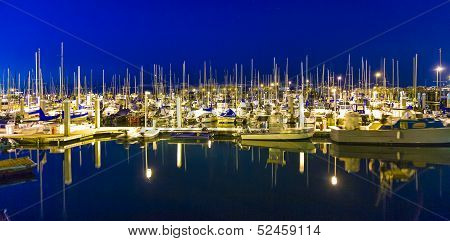 Sailing Boats In The Windless Monterey Harbor At The Pier By Night